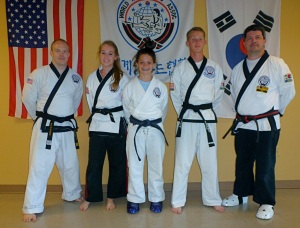 L to R: Master Jason Church, Sam Dan Katherine Robinson, Cho Dan Kelsey Strahan, E Dan Samuel Bond and Master Thomas Strahan.